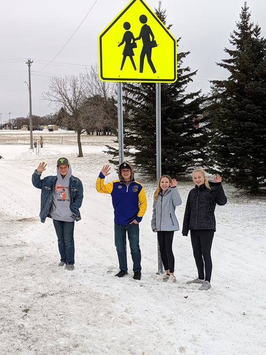 KAHS Students with MnDot sign