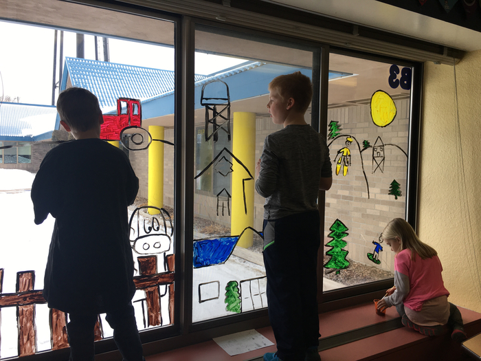 Students busy working on the mural.