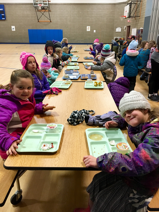 Many students have breakfast before going out to morning recess.