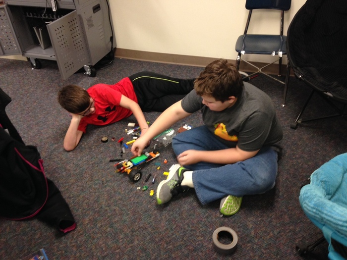 Sixth graders work on their alternative enery vehicles.