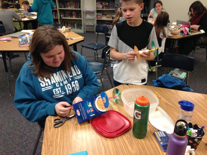 Sixth graders work on their alternative energy vehicles.