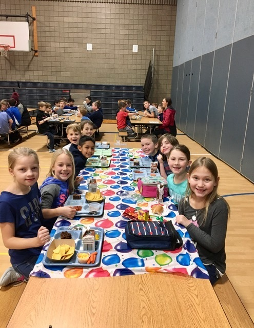 KES students enjoy lunch today at the Birthday Celebration Table.