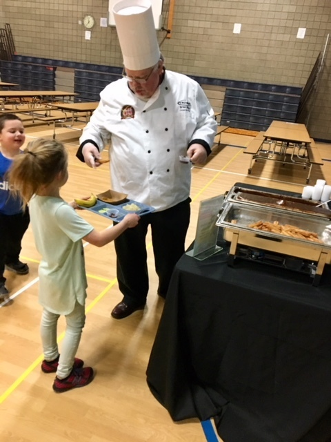 Chef Brain passed out Free Samples of Spanish Chocolate Dipping Sauce with Churros to Kimball Elementary Students during Lunch.